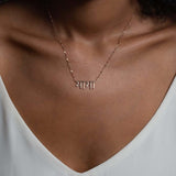 On Model Unique Hindi Mama Necklace in 14K Rose Gold Necklace accent diamonds by Au Xchange