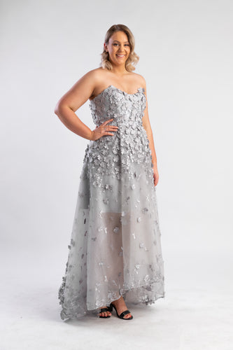Jane 3D Lace Gown by Bariano in grey. Detailed grey dress with tulle skirt and applique bodice.