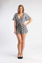 Load image into Gallery viewer, Black and white playsuit with deep v-neck