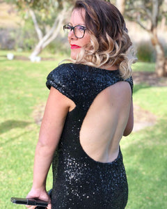 Black sequin dress with split leg and open back