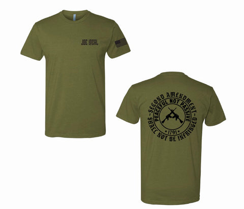 "Military green cotton short sleeve t-shirt. Joe Local logo on left pocket. The back of the t-shirt has a circular logo saying ""second amendment shall not be infringed. Also, within that circle is another circle with the phrase ""peaceful not passive, 1791"". Within that circle at the center are Two guns in center crossing each other.  Edit alt text"