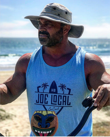 Joe Local SoCal Tank Top Neon Blue or Sky blue with navy Blue SoCal/HB shield Logo 50:50 Cotton / Polyester blend 4.8 oz / 165 gram Joe Local SoCal/HB shield Logo on front Joe Local Logo on back.