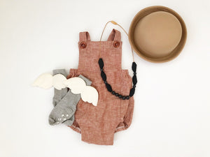 Rust colored gender neutral romper
