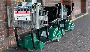 Multiple electric shopping carts outside store