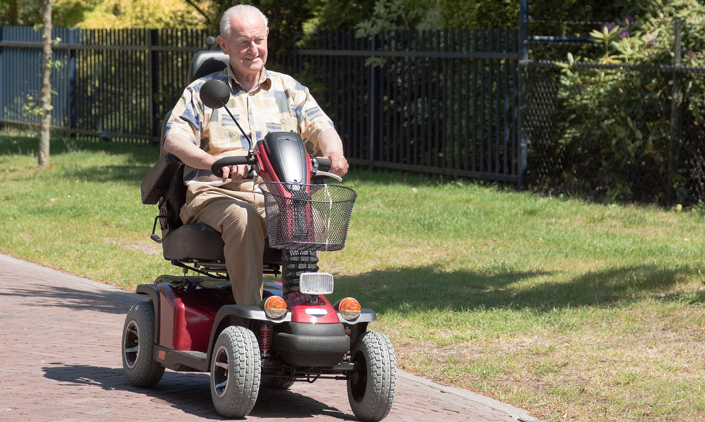 senior citizen on mobility scooter