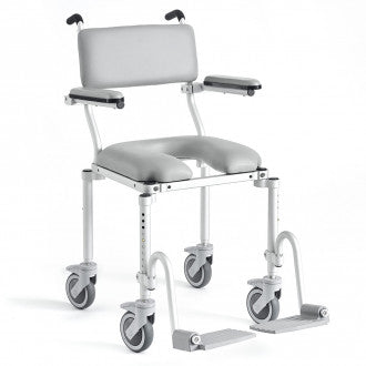 Nuprodx: Rolling commode and shower chair for use in barrier-free showers