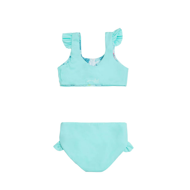 Back view Girls two piece eco-friendly reversible blue bikini swimsuit with ruffle detail.
