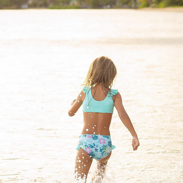 Girls two piece eco-friendly reversible blue bikini swimsuit with ruffle detail.