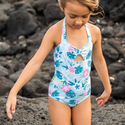 Girl's one-piece eco-friendly blue floral print swimsuit with tie at neck.