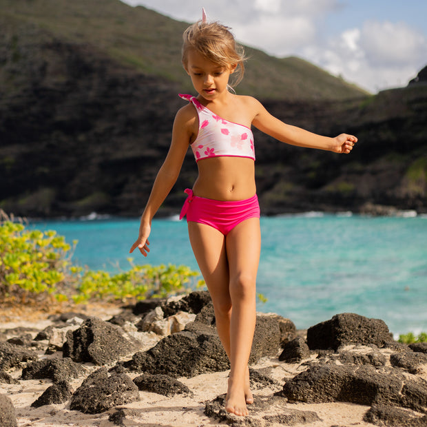 Sustainable girls two piece reversible swimwear in pink floral design