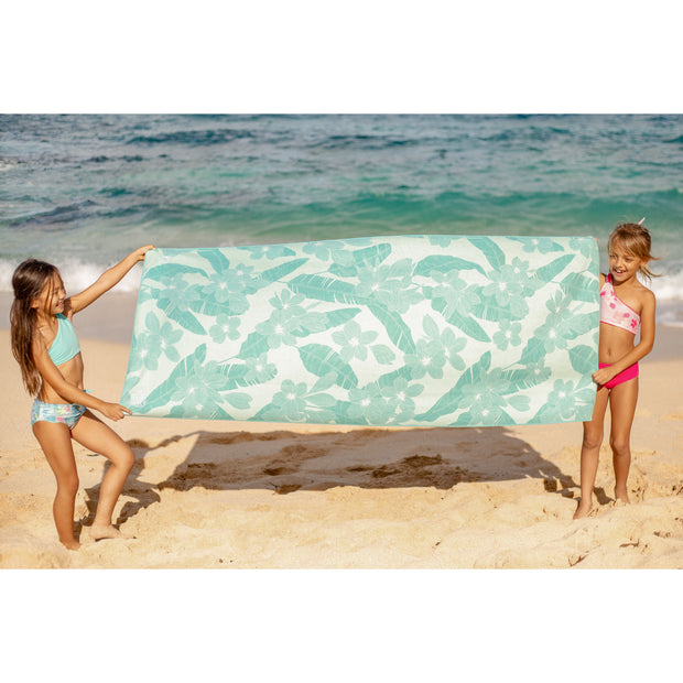 Girls holding sustainable beach towel on beach