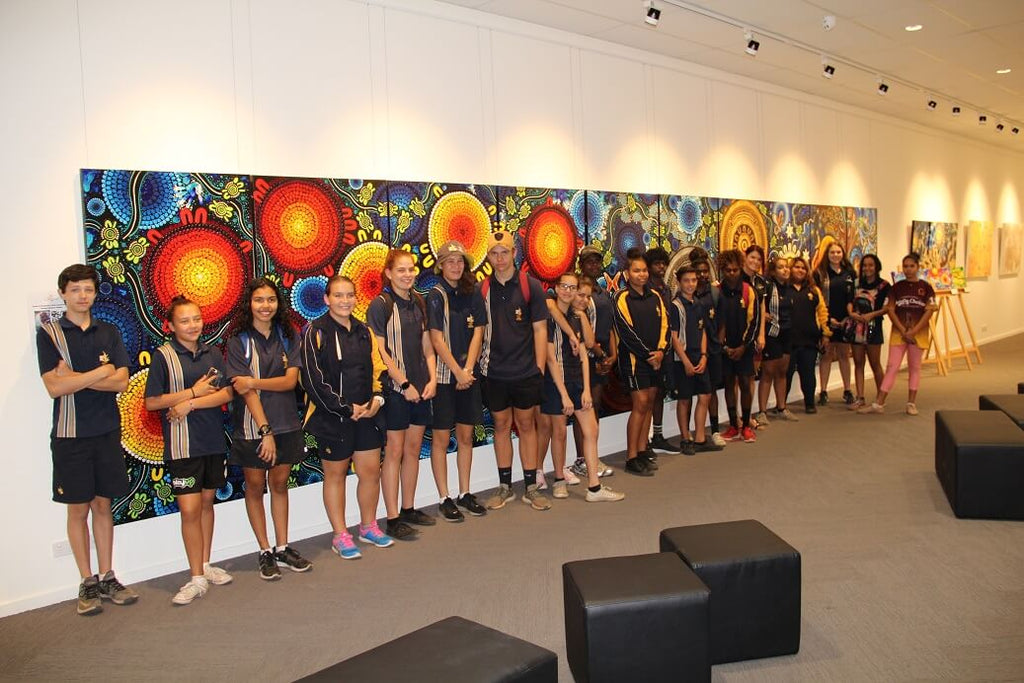 Chern'ee and Brooke hold aboriginal painting workshops with local children