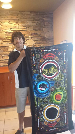 Rugby League Legend Johnathan Thurston displays Chern'ee's Artwork