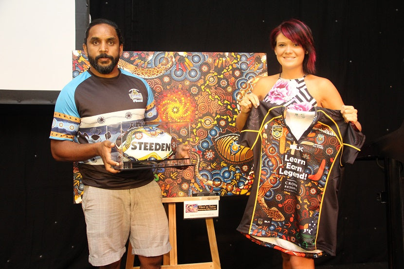 Preston Campbell gets presented with a painted Chern'ee Sutton football