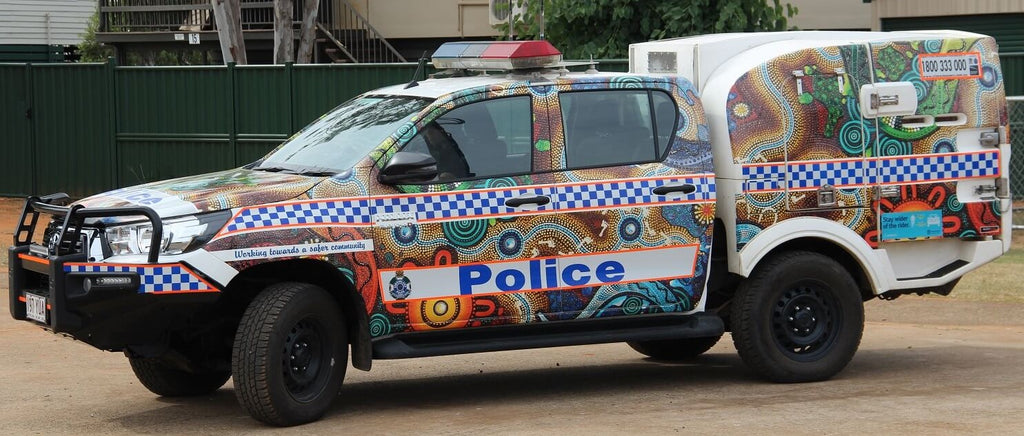 New police cars launched in Woorabinda for Reconciliation Week.