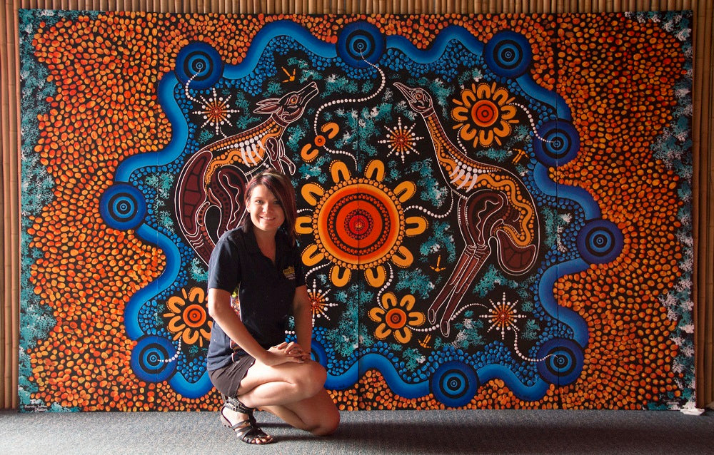Chern'ee Artist in Residence at Dreamworld on the Gold Coast Painting a Memorial