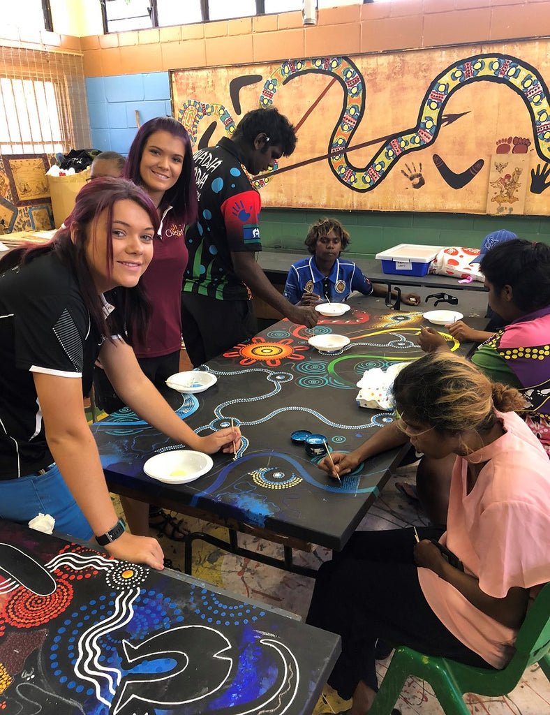 Chern'ee and Brooke Sutton Hold a Painting Workshop in Woorabinda with the Local Police and Children