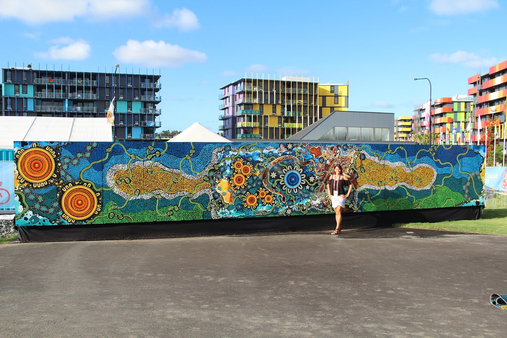 "Chern'ee's 14 metre painting called ""Journey To Gold"" goes on Display for the Commonwealth Games"