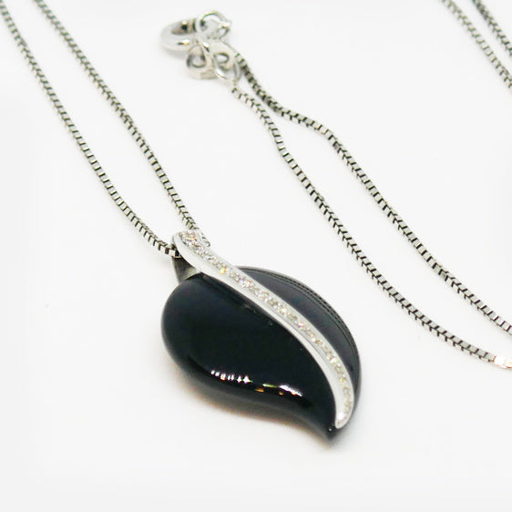 9ct white gold, onyx and diamond necklace (One only)