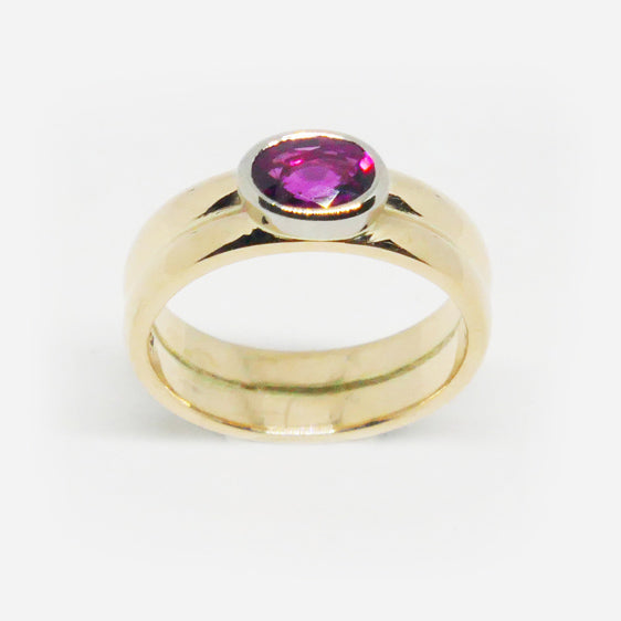 9ct yellow and white gold rub over set oval pink tourmaline ring