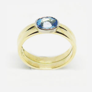 9ct yellow and white gold, oval blue topaz rub over set ring