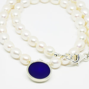 Cultured Freshwater pearl and sterling silver round resin pendant