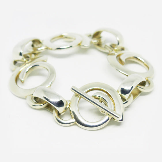 Large Sterling Silver tapered swirl bracelet with T bar clasp