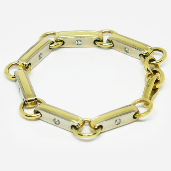 Handmade 9ct white and yellow gold rectangular double sided link bracelet with diamonds (12 in total) set into both sides of each link.