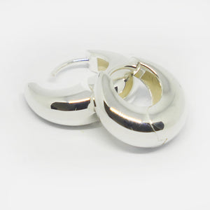 Sterling silver crescent shaped huggie earrings