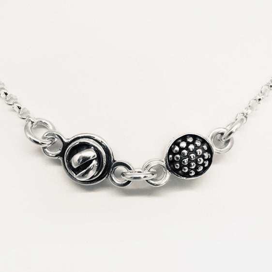 Sterling silver raspberry knot necklace