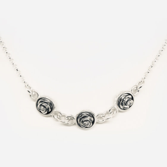 Triple, double sided oxidised roses in a row necklace