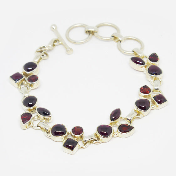 Sterling Silver mixed facetted and cabachon cut  Garnet  link bracelet