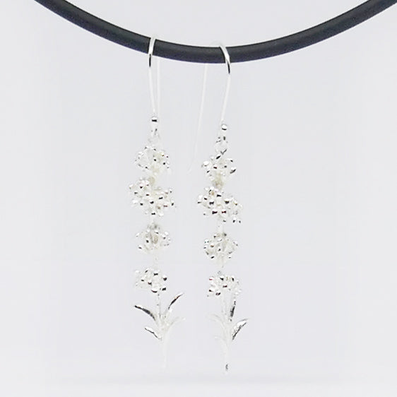 Long sterling silver flower drop earrings