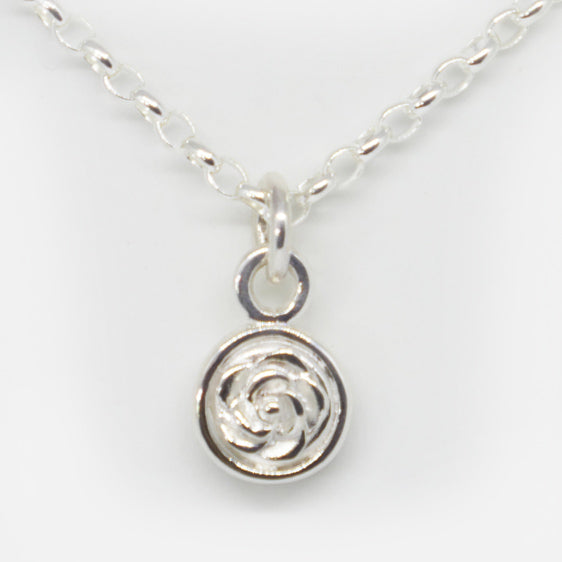 Sterling silver double sided rose pendant (chain sold separately)