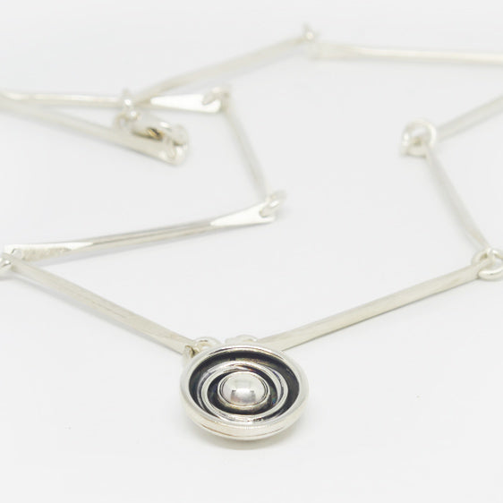 Sterling silver, matt, shiny, oxidised finishes, round orbit pendant