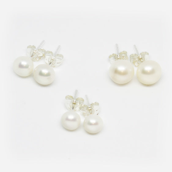 Fresh water pearl studs on Sterling Silver backs with butterflies