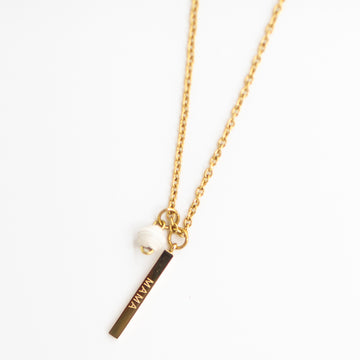 The Mama Charm Chain Necklace with white handmade paper bead on gold plated chain made by artisans in the Horn of Africa. Sustainable, Artisan-Made And Ethically Sourced