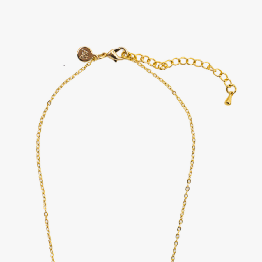 Close up view of the artisan made minimal Dainty Drop Necklace 18k gold plated chain with logo charm and extender chain