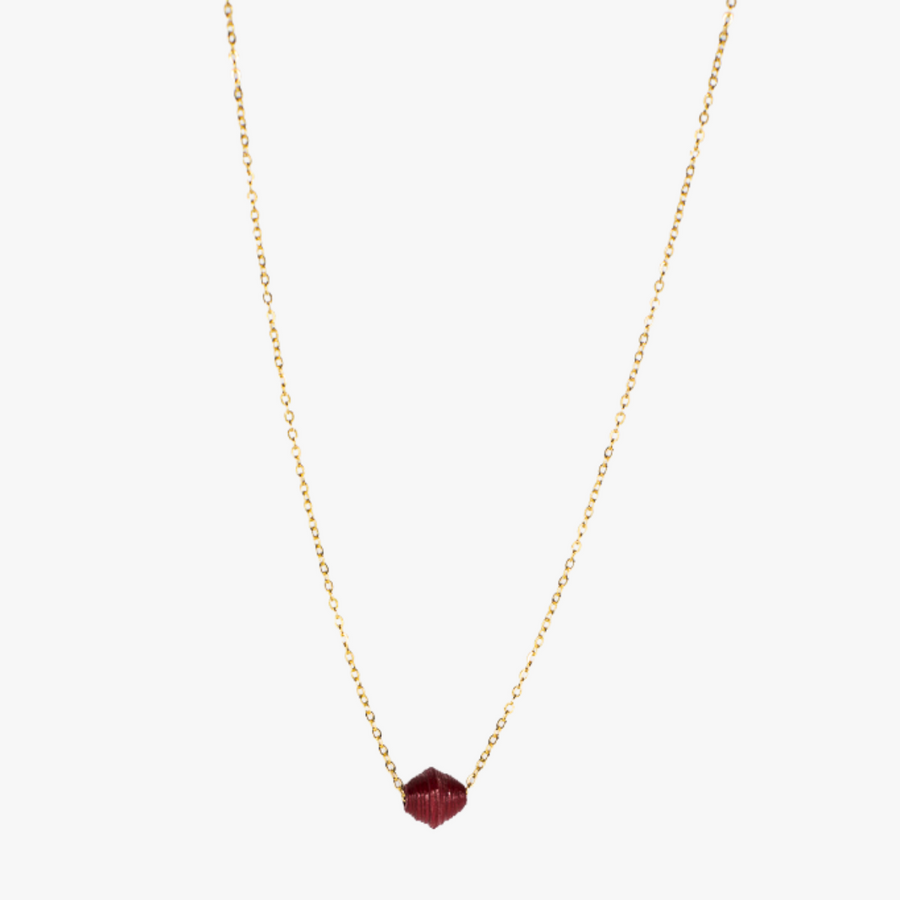 The Dainty Drop Necklace: dark redA handmade paper bead on 18k gold plated chain necklace made by artisans in the Horn of Africa. Sustainable, Artisan-Made And Ethically Sourced