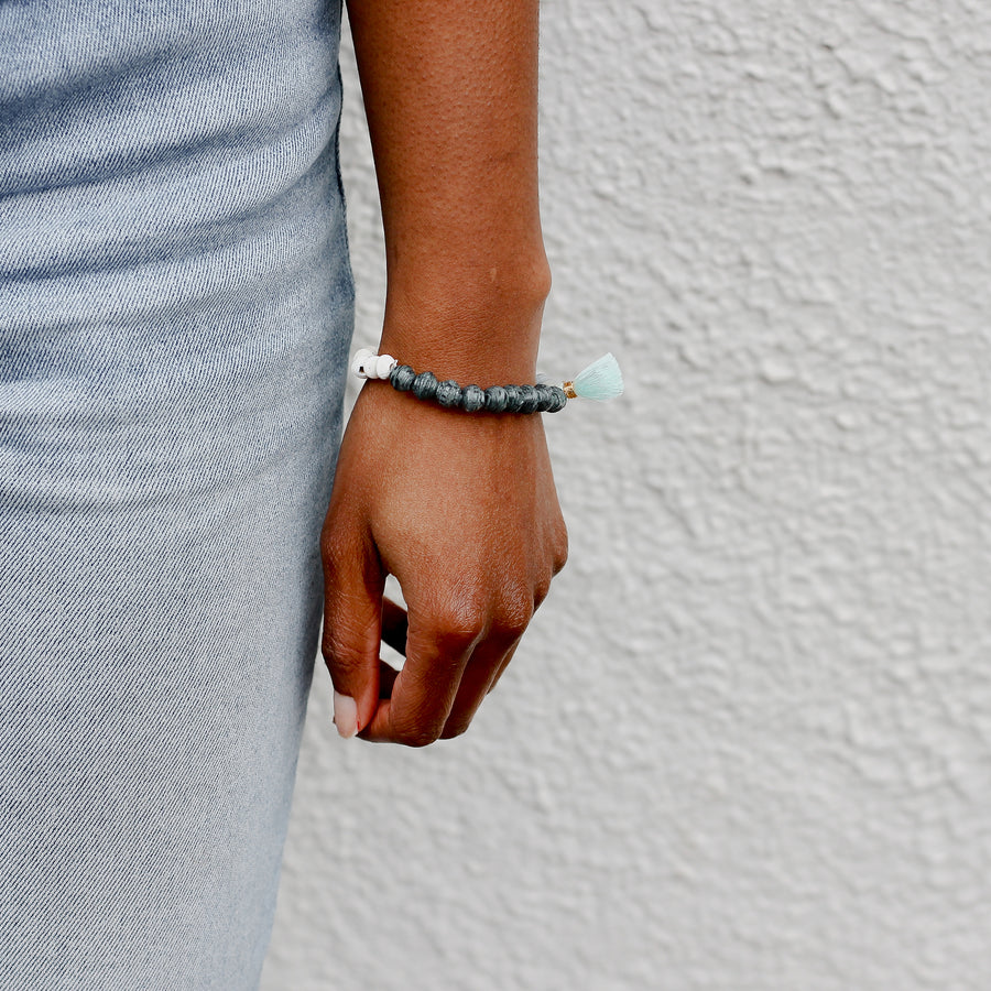 The Jetsetter Tassel Bracelet: blue handmade paper bead bracelet with tassel made by artisans in the Horn of Africa. Sustainable, Artisan-Made And Ethically Sourced