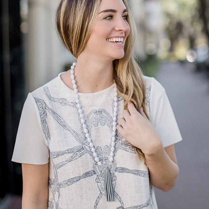 Le Blanc Necklace: white handmade paper bead with fair trade certified recycled glass beads and leather tassel necklace by artisans in the Horn of Africa