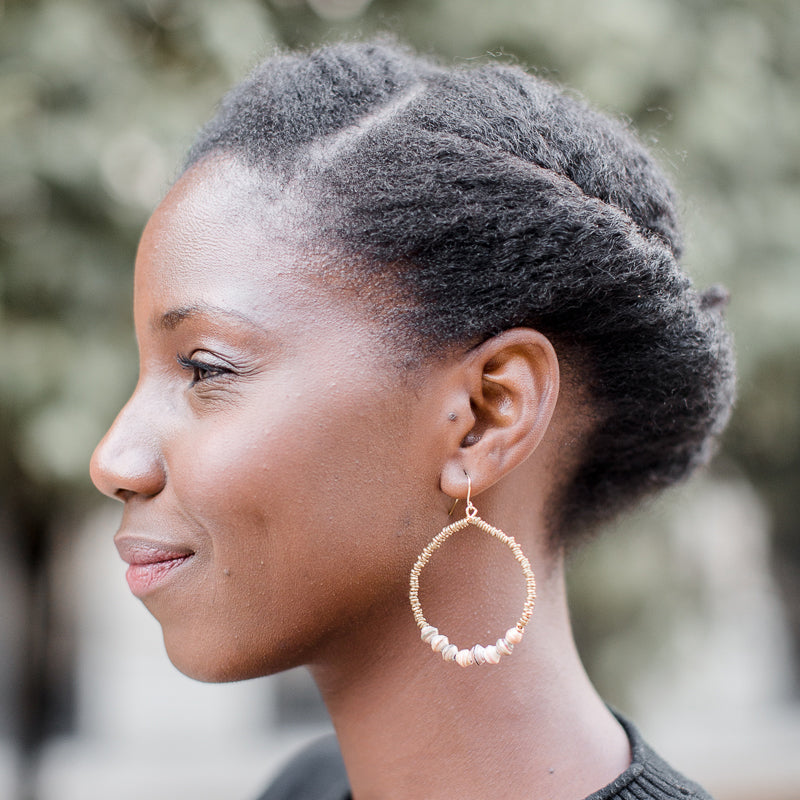 The Riyo Hoop Earrings: Black handmade paper beads with Ethiopian brass beads earrings made by artisans in the Horn of Africa. Sustainable, Artisan-Made And Ethically Sourced. Sustainable, Artisan-Made And Ethically Sourced