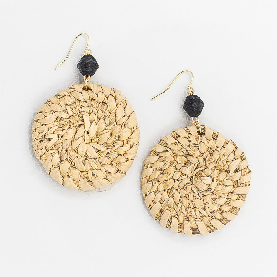 The Woven Ubah Earrings: woven circle with handmade black paper bead made by artisans in the Horn of Africa. Sustainable, Artisan-Made And Ethically Sourced. Sustainable, Artisan-Made And Ethically Sourced