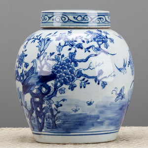 "This classic blue and white porcelain lidded ginger jar will bring chinoiserie chic to any decor. The ginger jar features a bird motif and looks amazing on a dining room side board or entryway chest.  Dimension: 8.5"" x8.5"" x 11"""