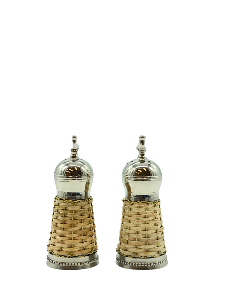 Set of salt and pepper shakers wrapped in a wicker basket weave raffia rattan. Coastal chic. Beach style nantucket style