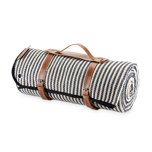 With its nautical pinstripes and waterproof lining, this blanket calls for a romantic picnic under a shady tree or a sunny lunch at the beach. A genuine leather carrier and four picnic stakes are conveniently included for a carefree outdoor date. Includes genuine leather carrier & 4 picnic stakes. Waterproof lining. Nautical pinstripe details. Makes a great gift.