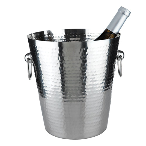 In the Forge Hammered Metal Ice Bucket, classically sculpted stainless steel is broken up by powerful blows for a hammered finish, resulting in sleek lines rent just enough to capture the light necessary for showcasing your wine. Stainless Steel Construction. Hammered Finish. Fits Standard Bottles