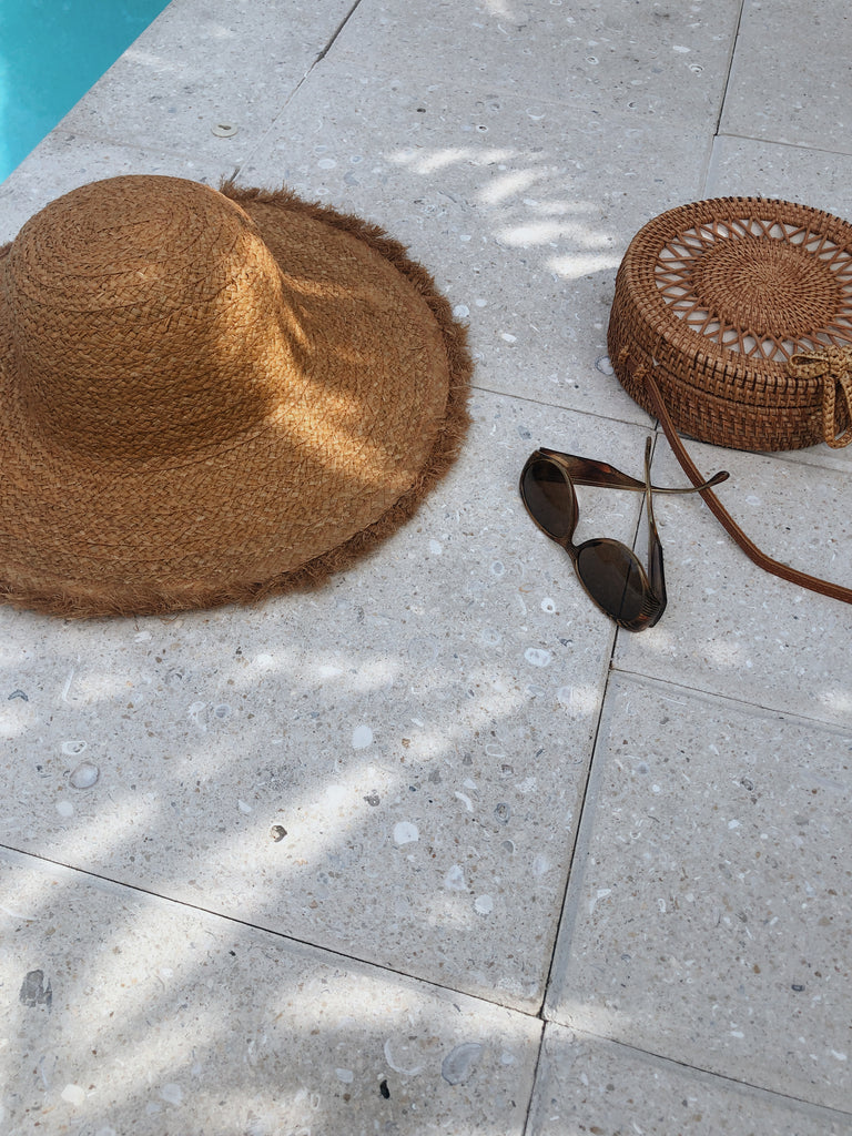 tan floppy brim beach hat
