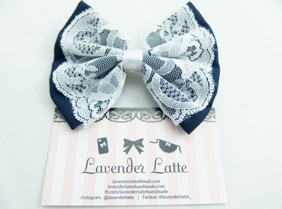 Navy Fabric Hair Bow with Pure White Lace Centre Overlay and White Satin Ribbon Hair Clip