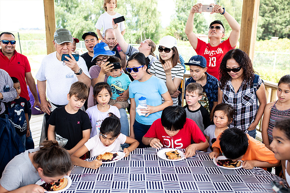 kids participating in blueberry pie eating contest